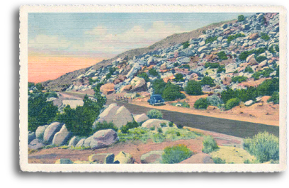 """Watch Out For Falling Rocks"" is a common sign seen along the highways in Northern New Mexico. This vintage postcard depicts the view that awaited many vacationing motorists in the 1950s."